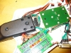 Fret board conceals wire slack
